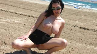 Ana Martin Beach Flash Pornstar brunette with big tits Ana Martin doing a strip by the sea