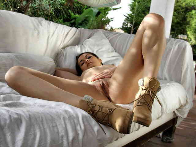 Geting nude on a couch  photo 16