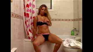 Sexy blonde teen making a strip in the bathroom  photo 05