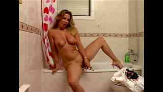 Sexy blonde teen making a strip in the bathroom  photo 11