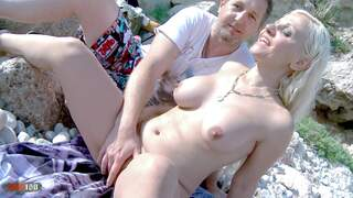 Nudist couple on a sunny beach