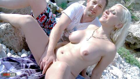 Nudist couple on a sunny beach photo 1