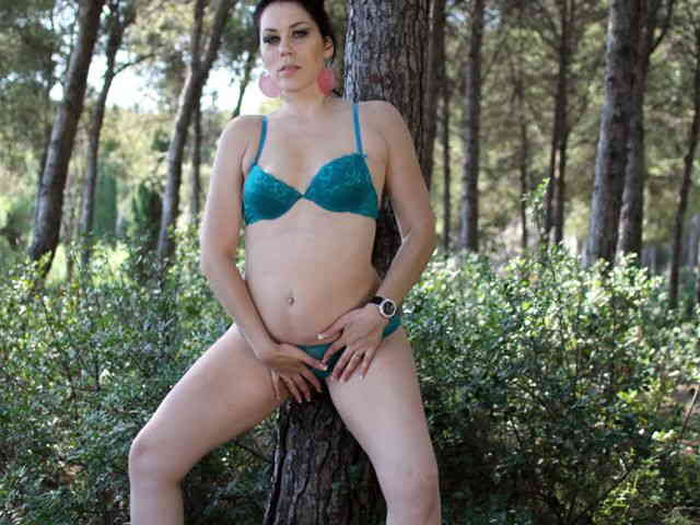 Horny brunette Erika Wolf getting naked in the woods   photo 08