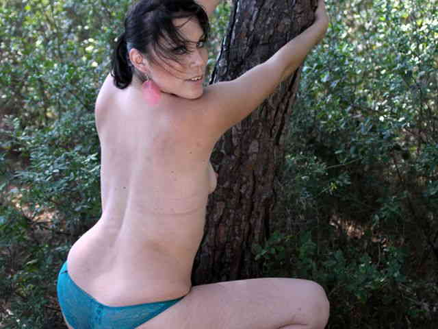 Horny brunette Erika Wolf getting naked in the woods   photo 14