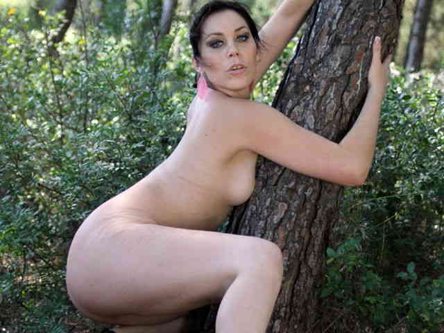 Horny brunette Erika Wolf getting naked in the woods   photo 16