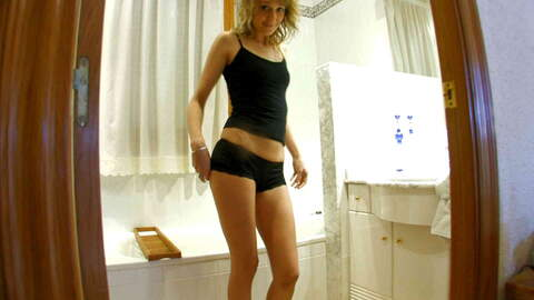 Pretty blonde Evy Sky dancing and stri...photo 3