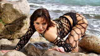 Mature brunette Heloise Dacosta doing a strip by the sea   photo 05