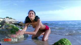 Great teen arab brunette Indiana Fox doing a strip on the beach   photo 11