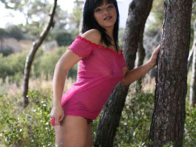 Great oriental Jade Kara doing a strip in the woods   photo 02