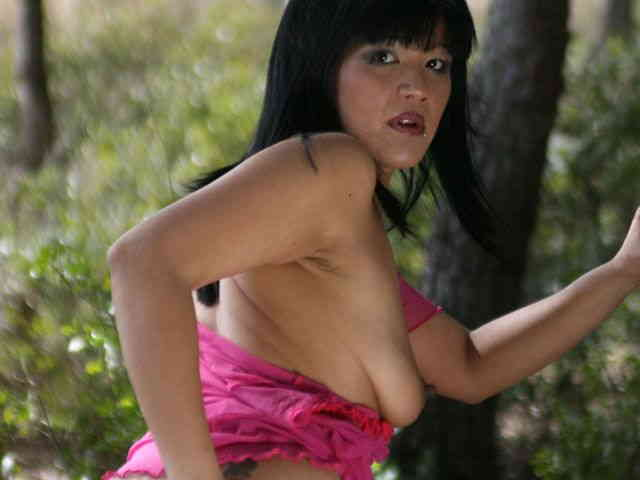 Great oriental Jade Kara doing a strip in the woods   photo 06