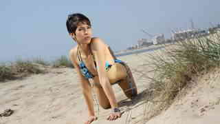 Pretty young arab brunette Jasmine Arabia dancing and stripping on the beach