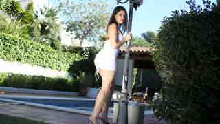 Great young brunette Jessica Bitch doing a hot striptease by the pool photo 1
