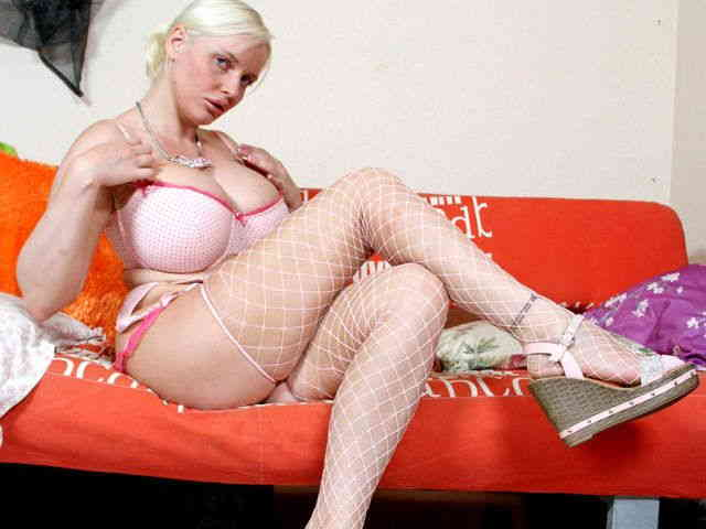 Blonde actrice geting nude on a sofa  photo 02