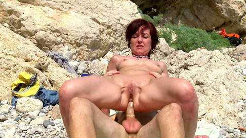 Hot French MILF on a sunny beach photo 1