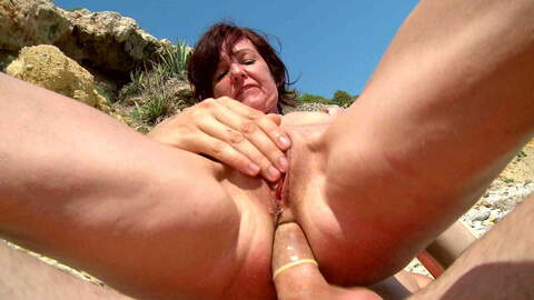 Hot French MILF on a sunny beach photo 3