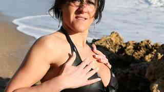 MILF brune geting nude at the beach
