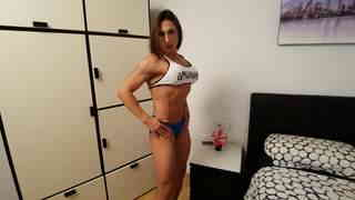 Gorgeous amazon showing her big muscles  photo 03