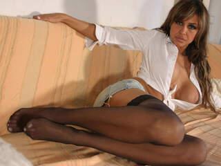 Karyna Sofa Hot Latina slut stripping in stockings