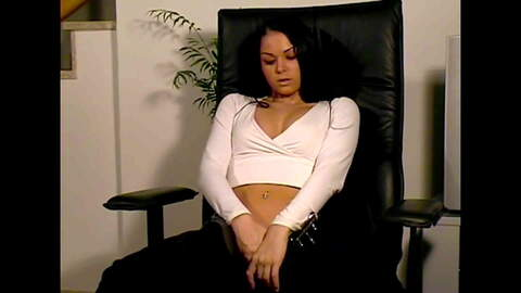 Kristina posing in a chair and strip o...photo 3