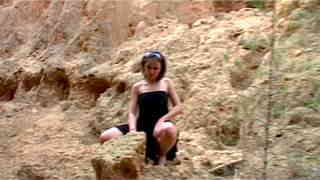 Krystal Wood Pretty petite Krystal doing a hot striptease in the woods