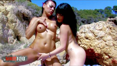Two hot pussies licking at the beach to attra...