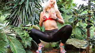 Horny young blonde Liz Rainbow doing a strip in the wild   photo 05