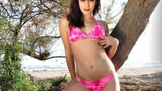 Nice teen Lucia Nieto doing a strip on the beach   photo 03