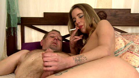 Smoking and giving a blowjob photo 1