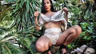 Pornostar brunette Mya Lorenn doing a hot striptease in the wild   photo 11