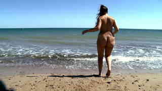 Young teeny girl playing naked on the beach  photo 11