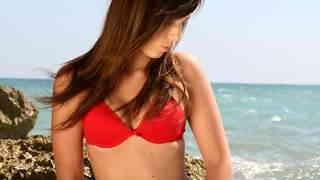 Brunnette in red bikini gets naked