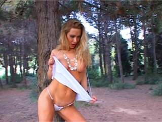 Sidjey Collins Blonde girl making a hot strip in the forest  HQ Full Size Photo