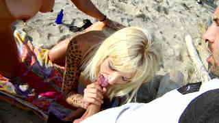 Hot exhibiting threesome at the beach   photo 03