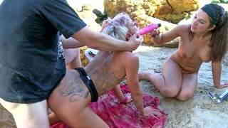 Anal threesome with two hot sluts on a public beach  photo 12