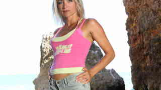 Nice MILF blonde Tamara Val dancing and stripping in the rocks photo 1