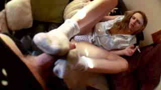 Sexy blond in panties doing foot job while smoking  photo 03