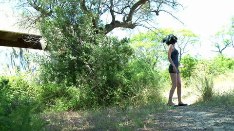 Tania Kiss peeing in the woods photo 1