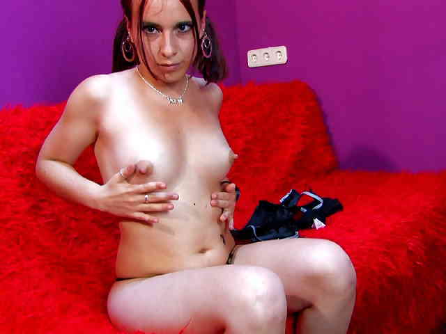 Horny young redhead Tania Teen removing clothes live on the webcam   photo 05