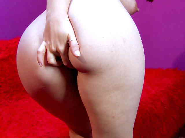 Horny young redhead Tania Teen removing clothes live on the webcam   photo 11