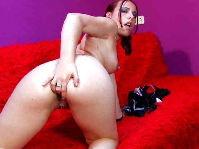 Horny young redhead Tania Teen removing clothes live on the webcam   photo 15