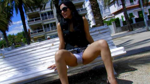 Hot latina teen having a public pee in...photo 1